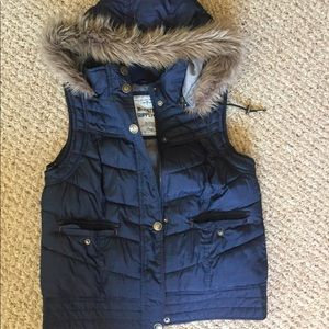 Blue puffer vest with hood and pockets